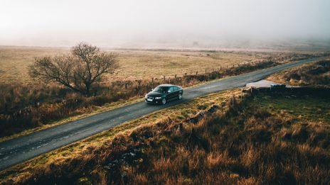 A car driving along a quiet road through a Moore