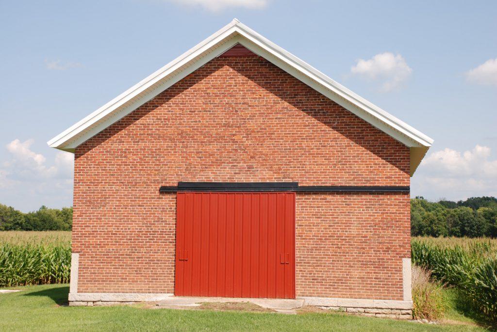 A brick garage in a field
