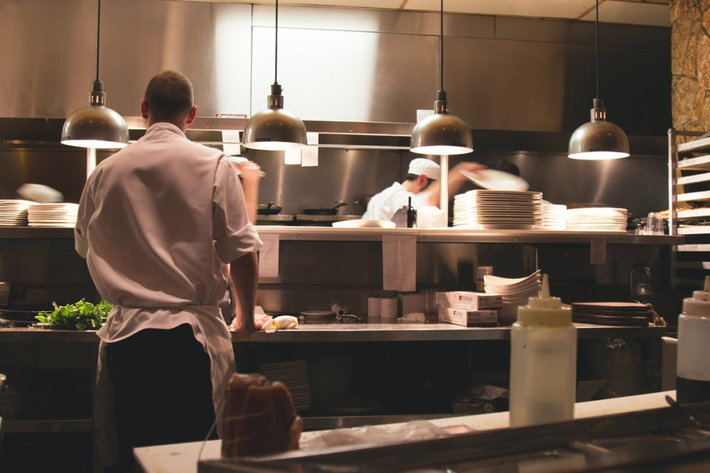 A chef working in a busy kitchen