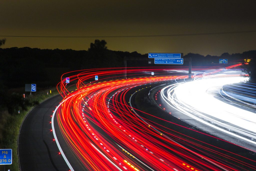 A time lapse of a a busy motorway corner at night
