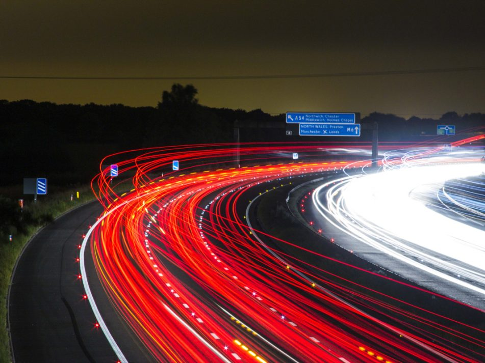 A time lapse of a motorway at night with trails of car lights