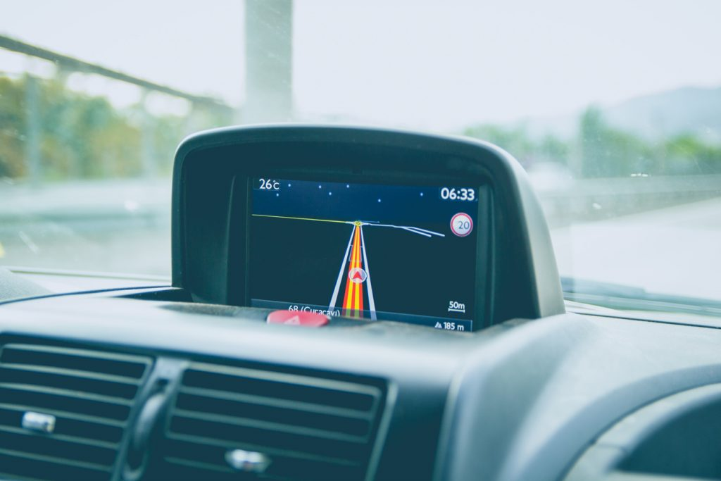 A sat nav with a journey planned out on screen