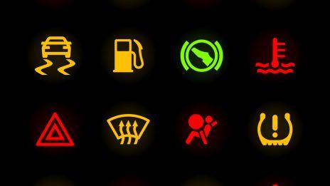 Various warning light symbols against a black backgorund