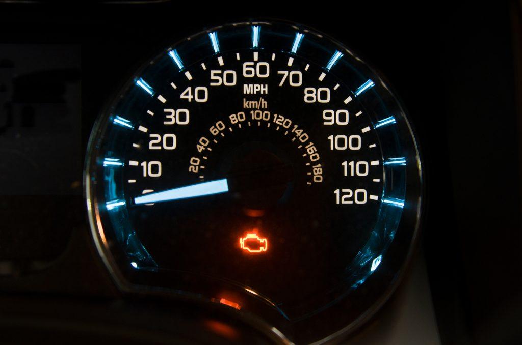 An engine warning light lit up on a speedo